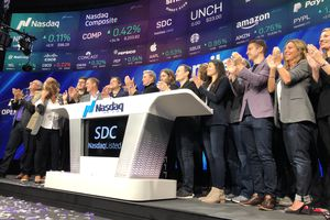 Members of the SmileDirectClub team celebrate ringing the bell at Nasdaq on their IPO day.