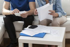Couple checking receipts and statements