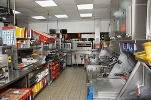 The interior of a fast food restaurant kitchen