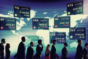 Busy people walking in front of a map of the world with listed stock exchanges.