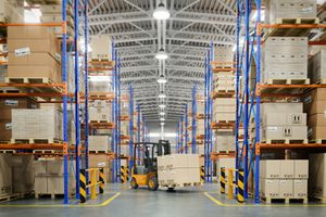 Forklift Truck in Warehouse or Storage and Shelves With Cardboard Boxes