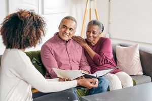older couple speaking with financial advisor
