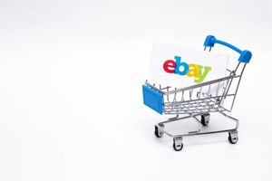 BOBRUISK, BELARUS - JANUARY 30, 2019: Shopping trolley on a white background online store, marketplace Ebay, online store