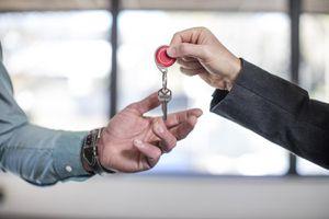 Estate Agent Handing Keys to Homebuyer