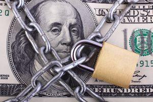 Padlock on Hundred Dollar Bill
