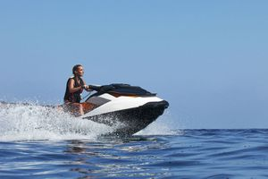 Woman driving jetski on the open water
