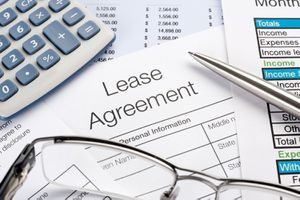 Lease Agreement Form With Pen, Calculator
