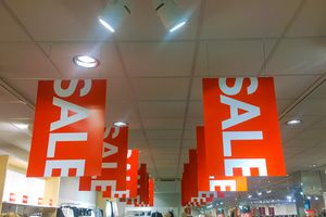 Factory close-out sale with huge orange and white