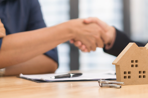 Couple shaking hands with lender
