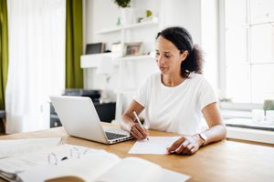 A woman collects all the info she needs to apply for mortgage preapproval.