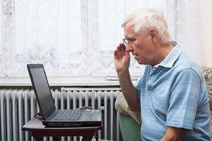 Older man in front of laptop
