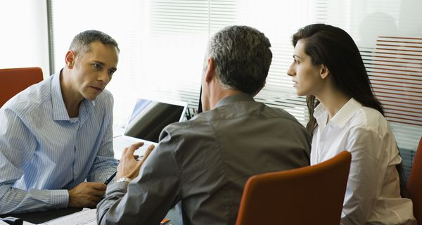 Businessman meeting with clients.