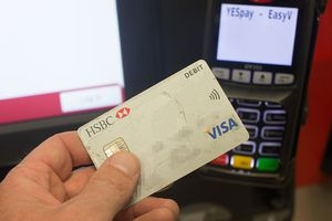 photo illustration a debit card is seen being used in a chip and pin machine