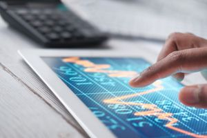 Man Hand With Digital Tablet Analyzing Stock Market Growth