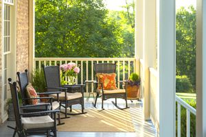 Sunlit porch with rocking chairs