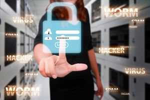 Conceptual image of red-headed woman in cyber storage facility touching a lock on a screen