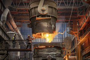 Steelworker starting molten steel pour