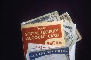 A Social Security card with dollar bills.