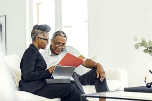 Couple reviews financial documents at home
