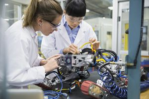 Engineers Assembling Robotics in Factory