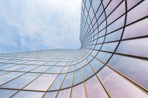 curved skyscraper on blue sky