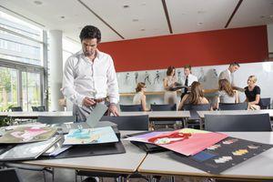A businessman examining fabric in various portfolios
