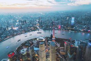 Shanghai, China financial market at sunset.