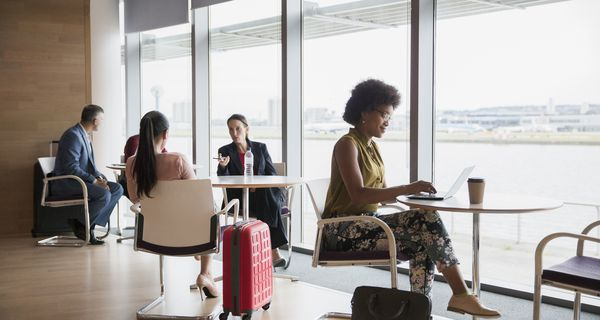 Business people working in airport business lounge