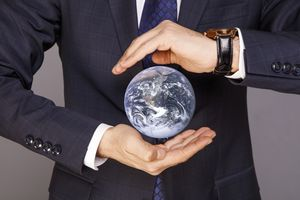 Blue planet Earth in Businessman hands