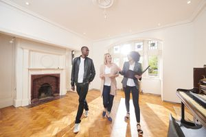 real estate agent speaking with couple in new home