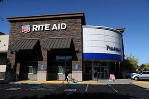 The Rite Aid logo is displayed on the exterior of a Rite Aid pharmacy.