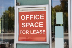 Office space for lease sign outside of an office building