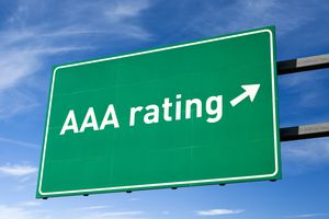 Highway directional sign for AAA credit rating.