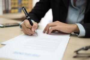 Woman signing job contract