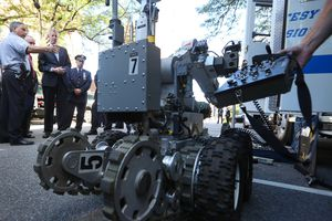 New York City Mayor Bill de Blasio and NYPD Commissioner William J. Bratton being briefed on Emergency Service Unit Equipment involving a robot.