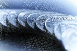 Bitcoins on blue binary code background