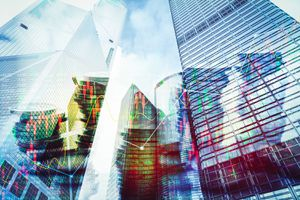 Double Exposure Image of Coin on City With Technology Financial Graph Background