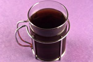 An image of cold-brewed coffee in a glass coffee cup.