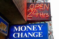 Signs outside a currency exchange storefront that say