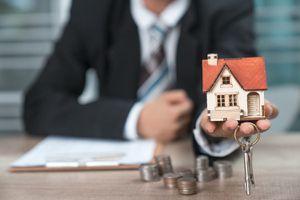 House Key in Home Insurance Broker Agent's Hand