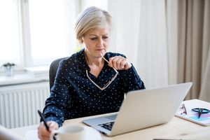 A Portrait of Active Senior Woman With Laptop Working in Home Office