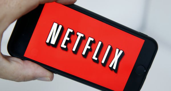 In this photo illustration, the Netflix media service provider's logo is displayed on the screen of a smartphone