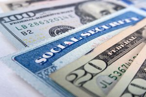 A social security card and American money dollar bills.
