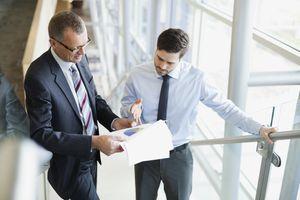 Businessmen discussing pie chart