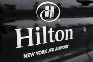 A close-up of the logo for the Hilton Hotel at John F Kennedy International Airport (JFK), Queens, New York.
