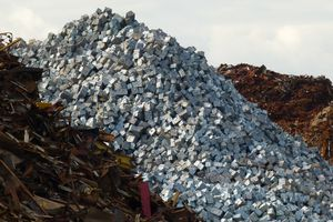 Scrap Mountain. Rough scrap, cubed metal and metal swarf ready for loading onto a bulk carrier at Liverpool Alexandra Branch Dock, Liverpool, 19.03.11.