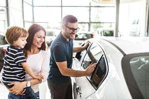 Family shops for a new car at dealership