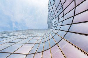 Curved skyscraper against blue sky