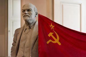 Statue of Vladimir Lenin with USSR flag established in 1923