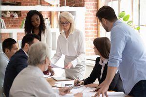 Diverse team do paperwork analyzing financial report